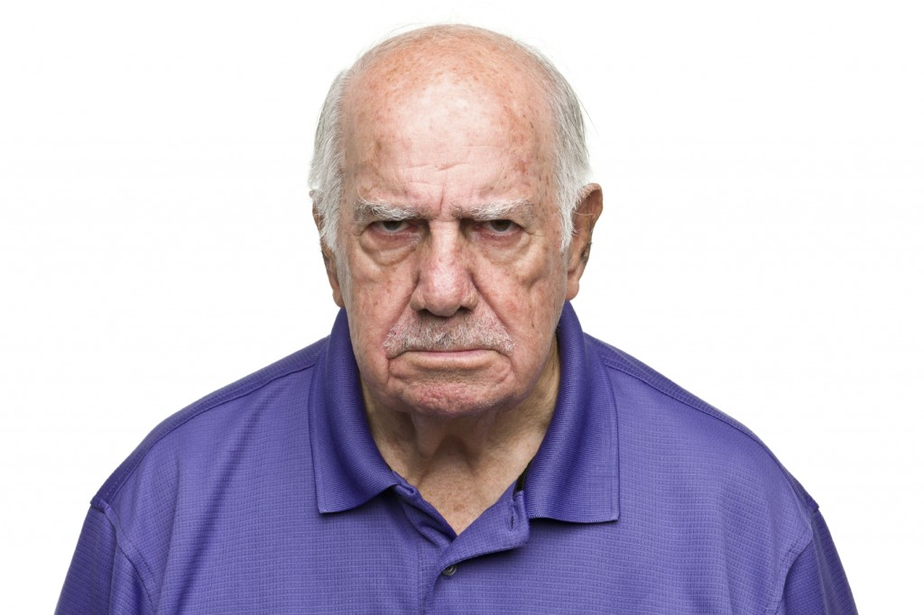 Angry old man, confused by tech