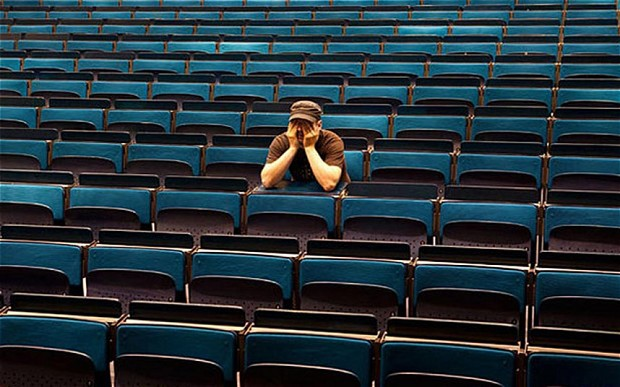 Some guy sits all alone because he has no friends. All of them are on FB.