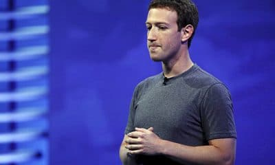 mark zuckerberg holding his hands on stage