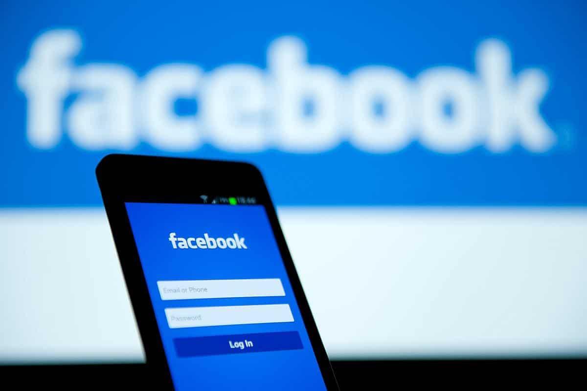 facebook login screen with facebook logo in background