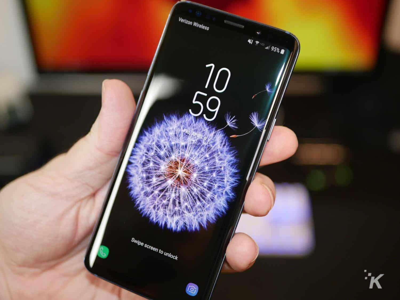 man holding galaxy s9 smartphone
