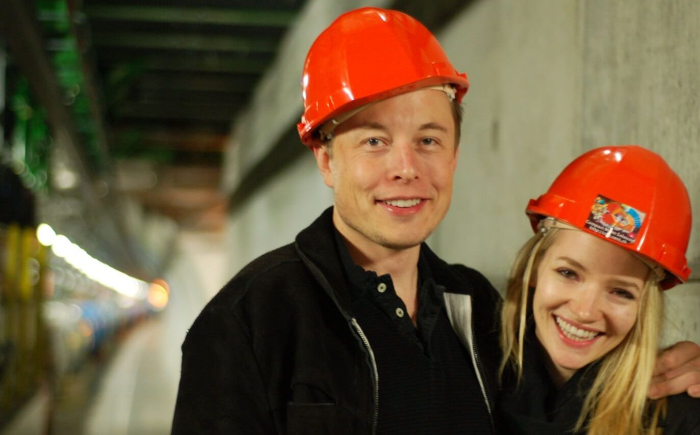 boring company elon musk in tunnel with hard hat on