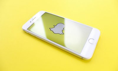 snapchat app displayed on iphone against yellow background