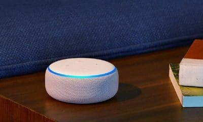 an amazon echo device against a blue background