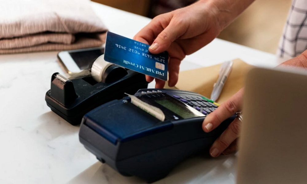 credit card being swiped at a point of sale