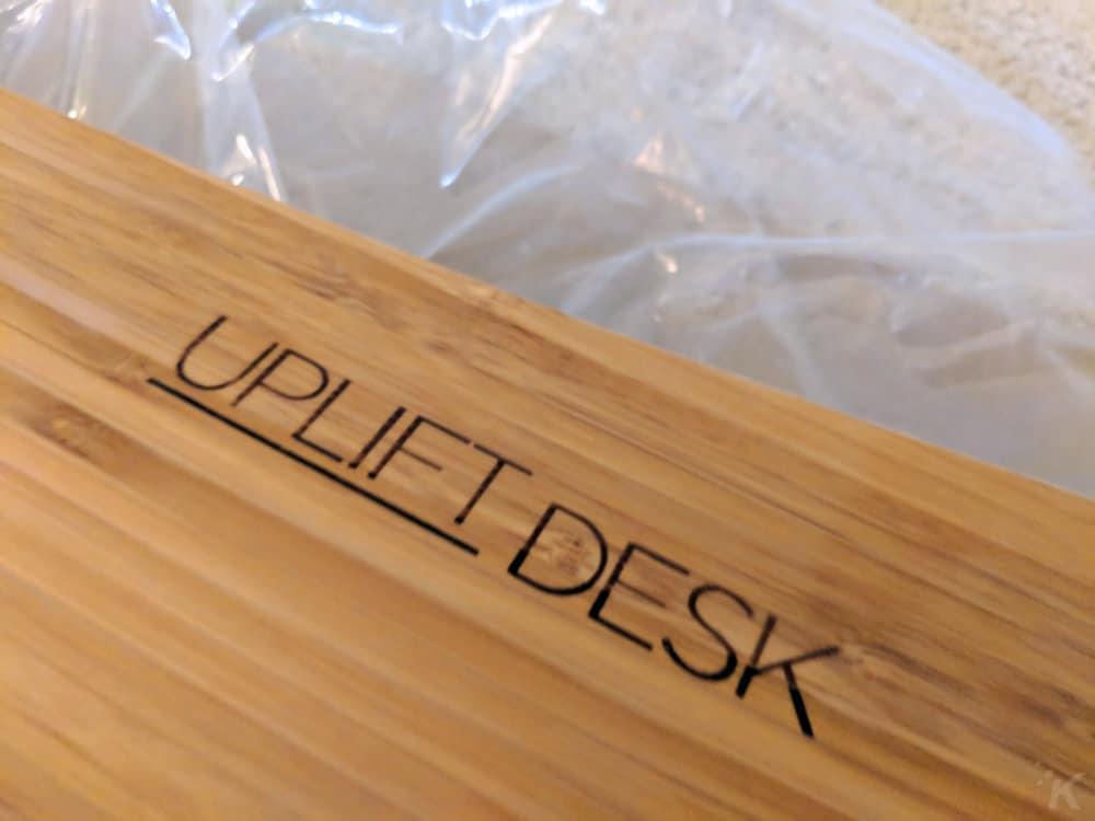 uplift desk logo on bottom of desktop