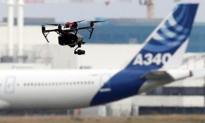 a drone flying around an airport faa