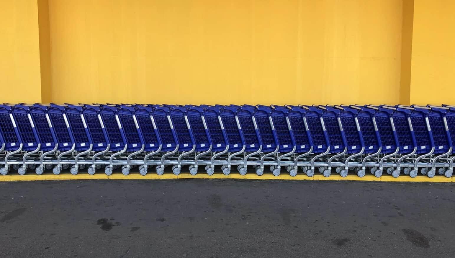 walmart shopping carts against yellow wall