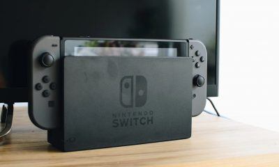 nintendo switch in dock on tv stand