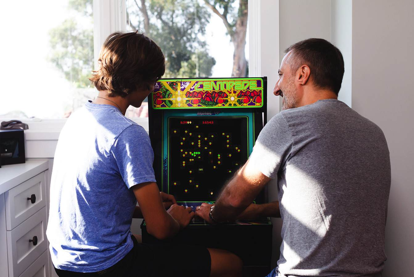 guys playing an arcade