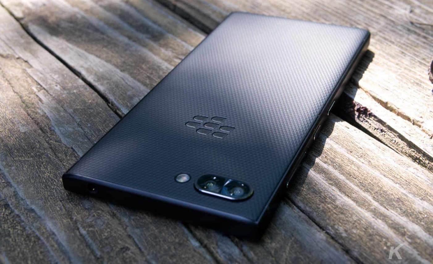 blackberry key2 smartphone on wooden table