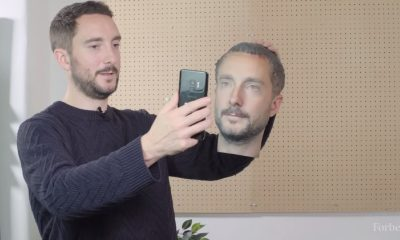 a picture of a man tricking facial recognition by using a 3D printed head