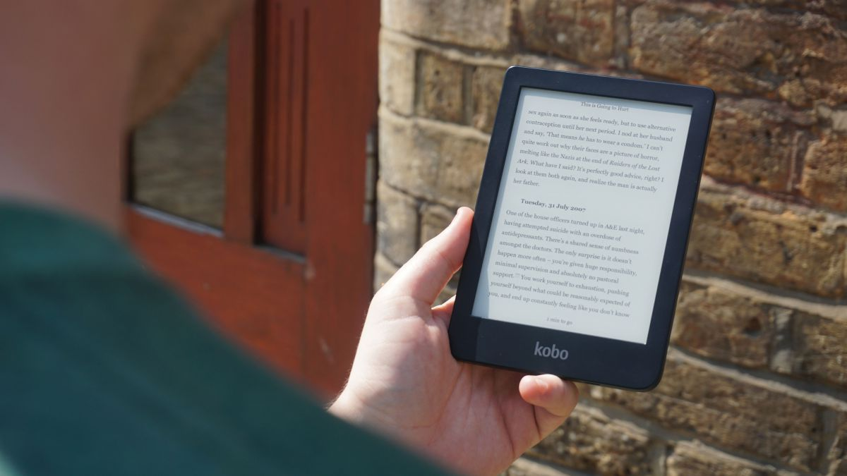 person holding a kobo clara hd ereader