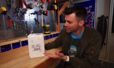 mark rober youtube sitting with a glitter bomb decoy package for porch pirtates