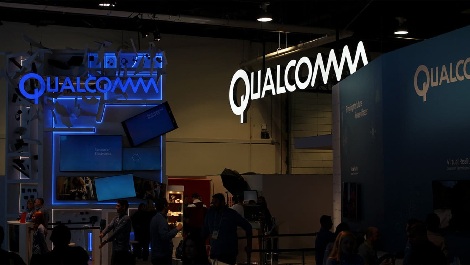 qualcomm signage hanging up near booth