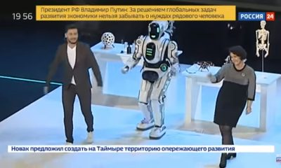man posing as an intelligent robot on stage
