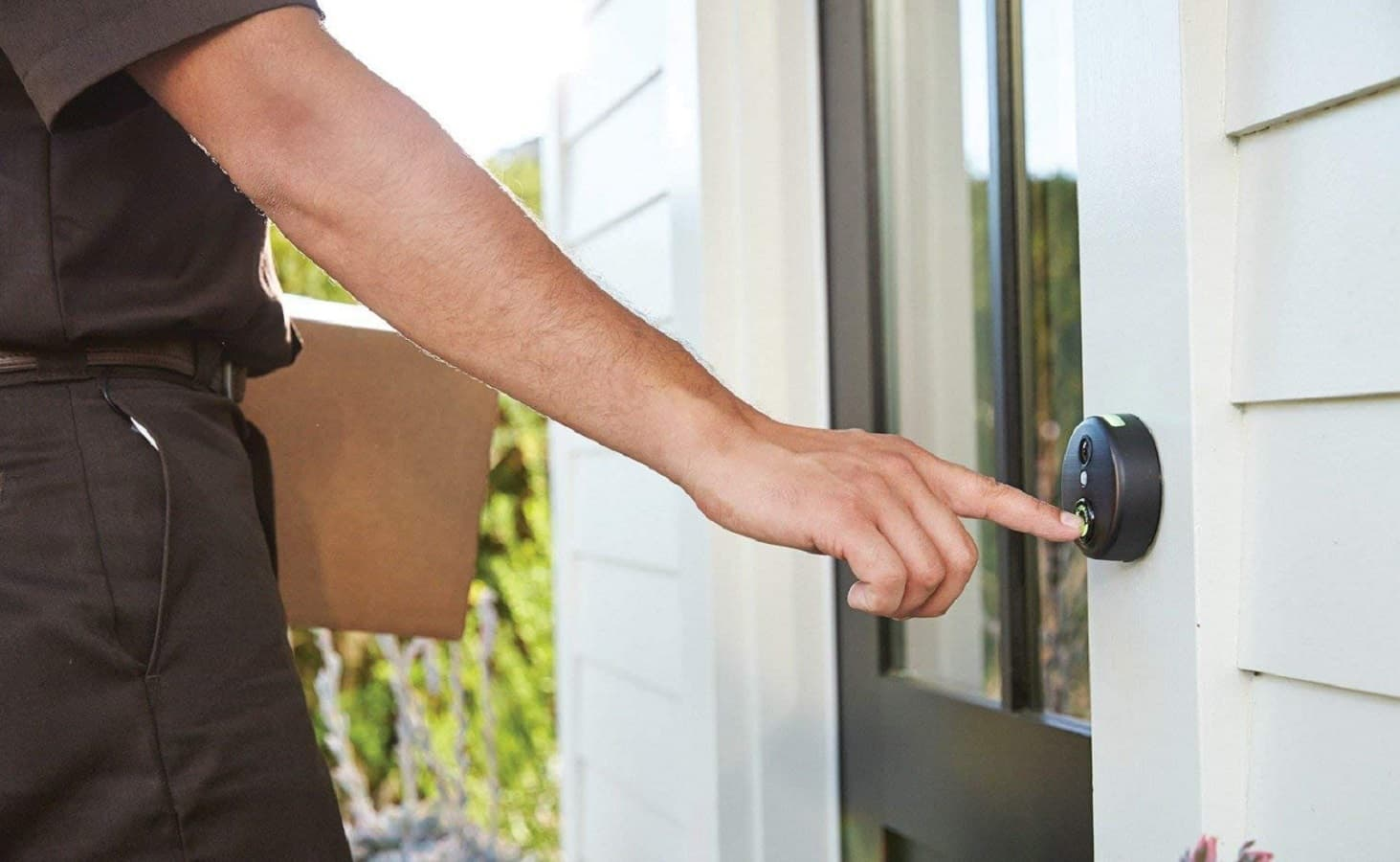 skybell doorbell being pressed on doorframe