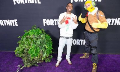 soulja boy poses with a bush at fortnite event