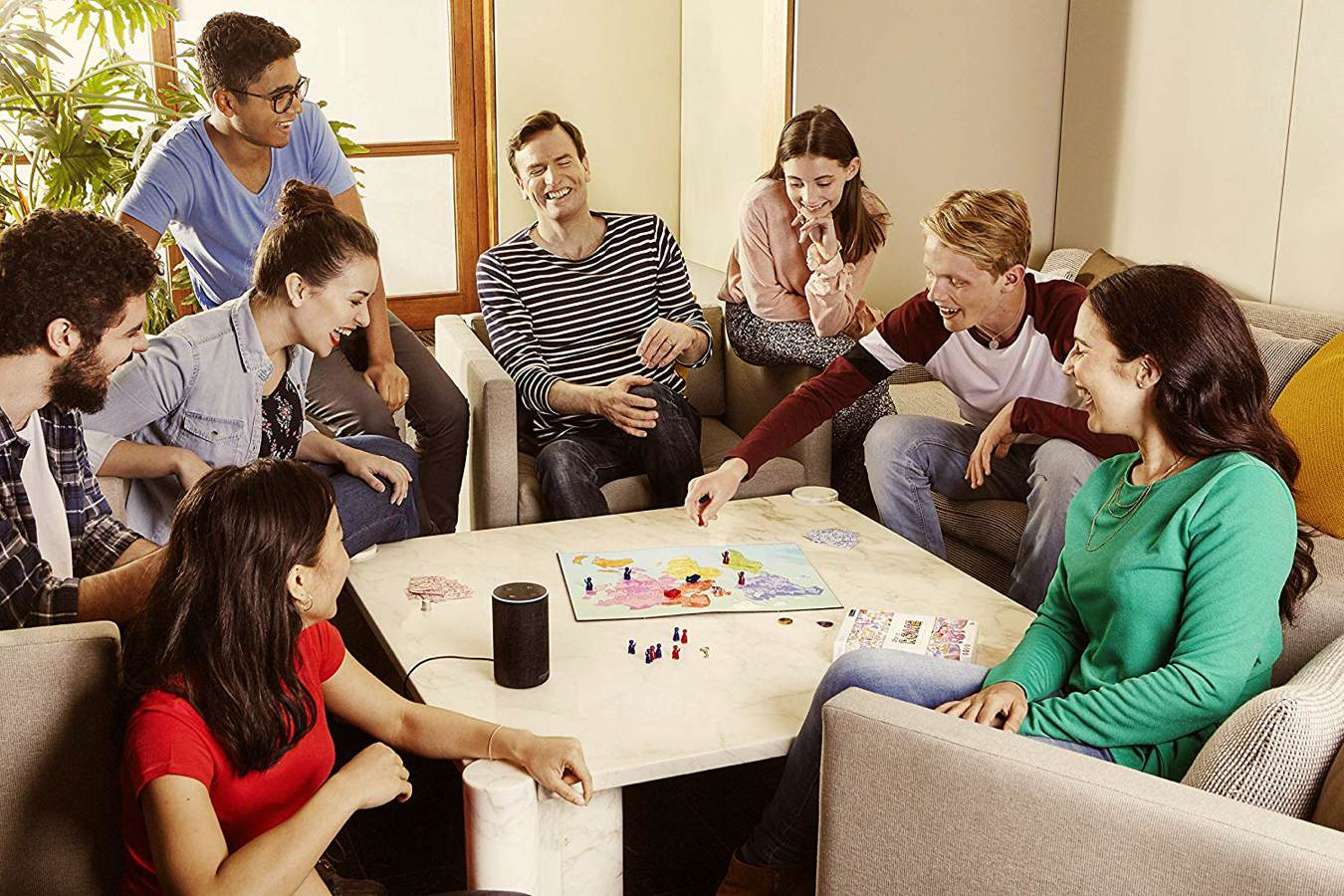 people in a room playing voice original's when in rome board game