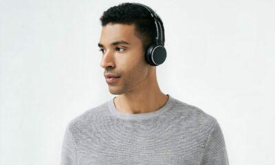 status audio bt one headphones on man
