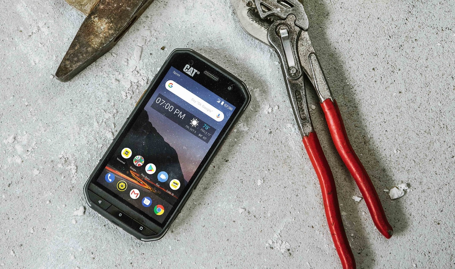 cat s48c smartphone on table with tools