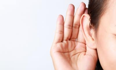woman holding her hand up to her ear diapason tinnitus app