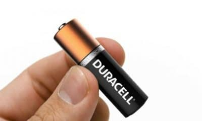 someone holding a duracell battery