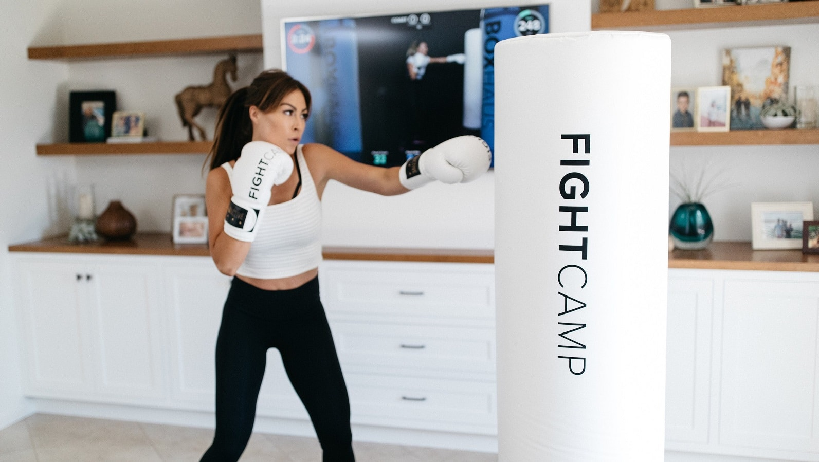 person using fightcamp in bedroom