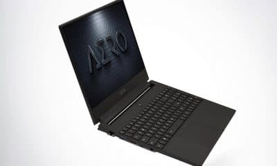gigabyte aero laptop with ai on grey background