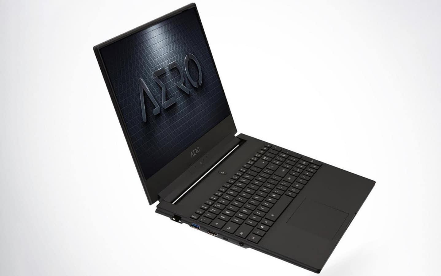 gigabyte aero laptop with ai on grey background