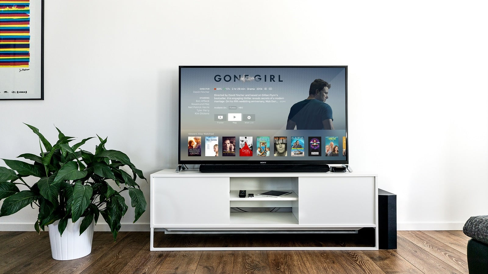 smart tv on white stand