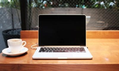 macbook on wooden table