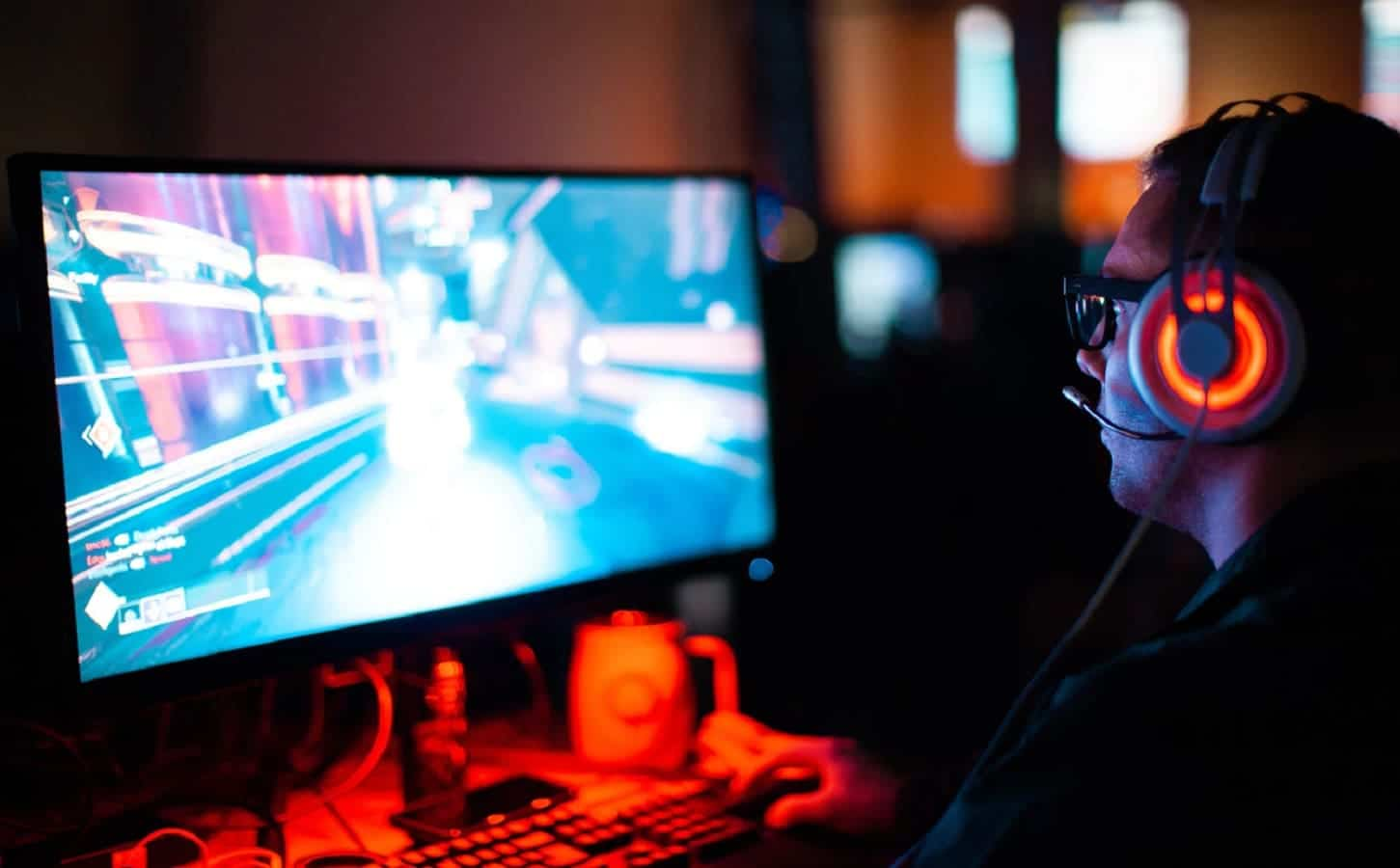 man playing games on computer