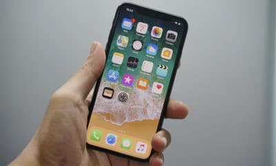 apple iphone with ios 13 apps on screen