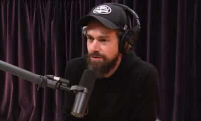 jack dorsey of twitter on joe rogan's shoe with black hat and hoodie