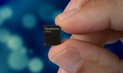 qualcomm x55 5g modem held between fingers