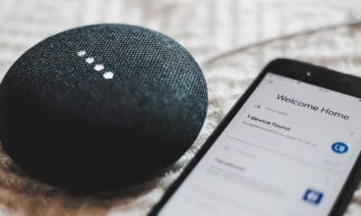 google home on table with google home app on phone
