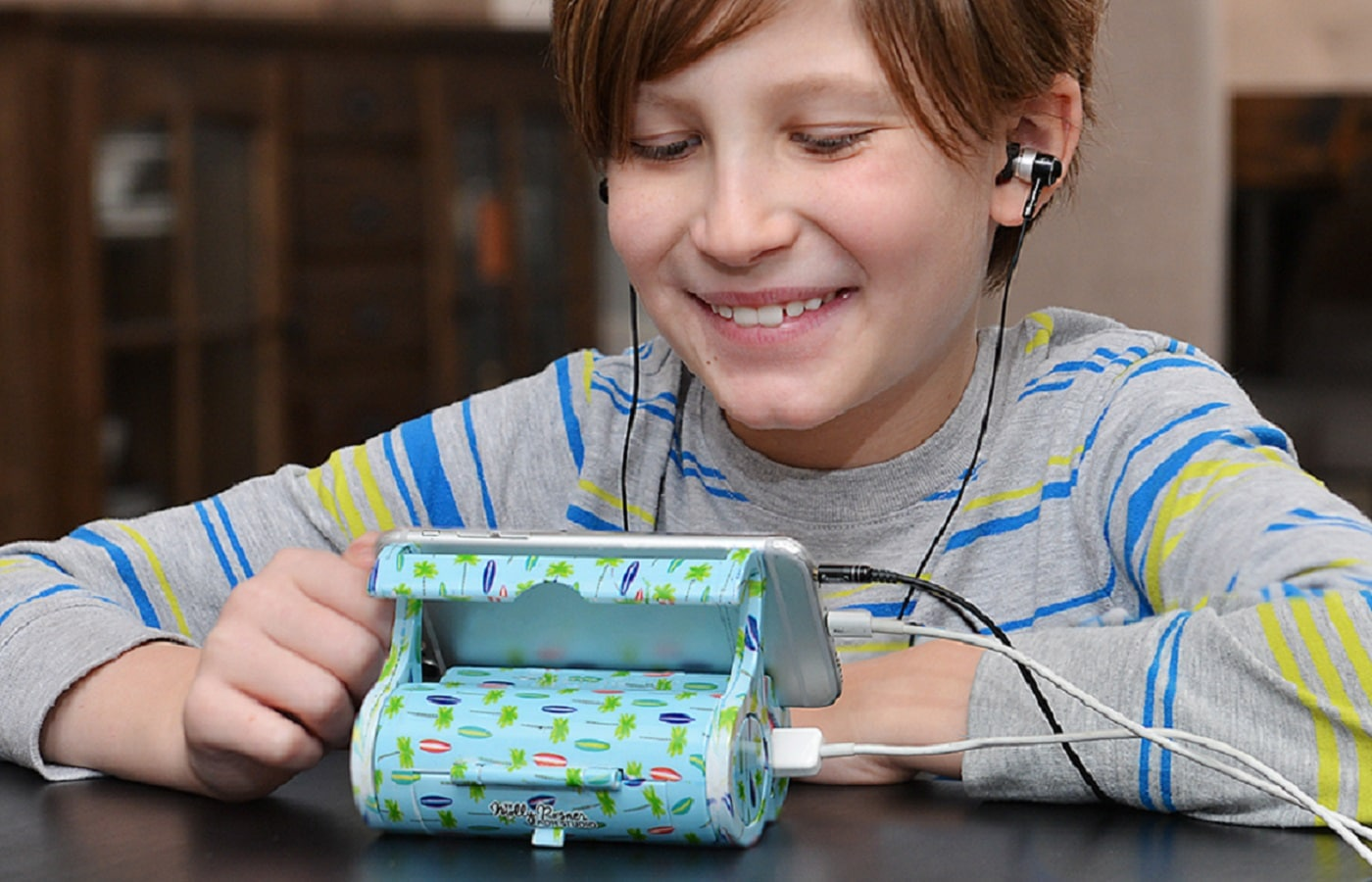 icaddy phone stand and charger being used by kid