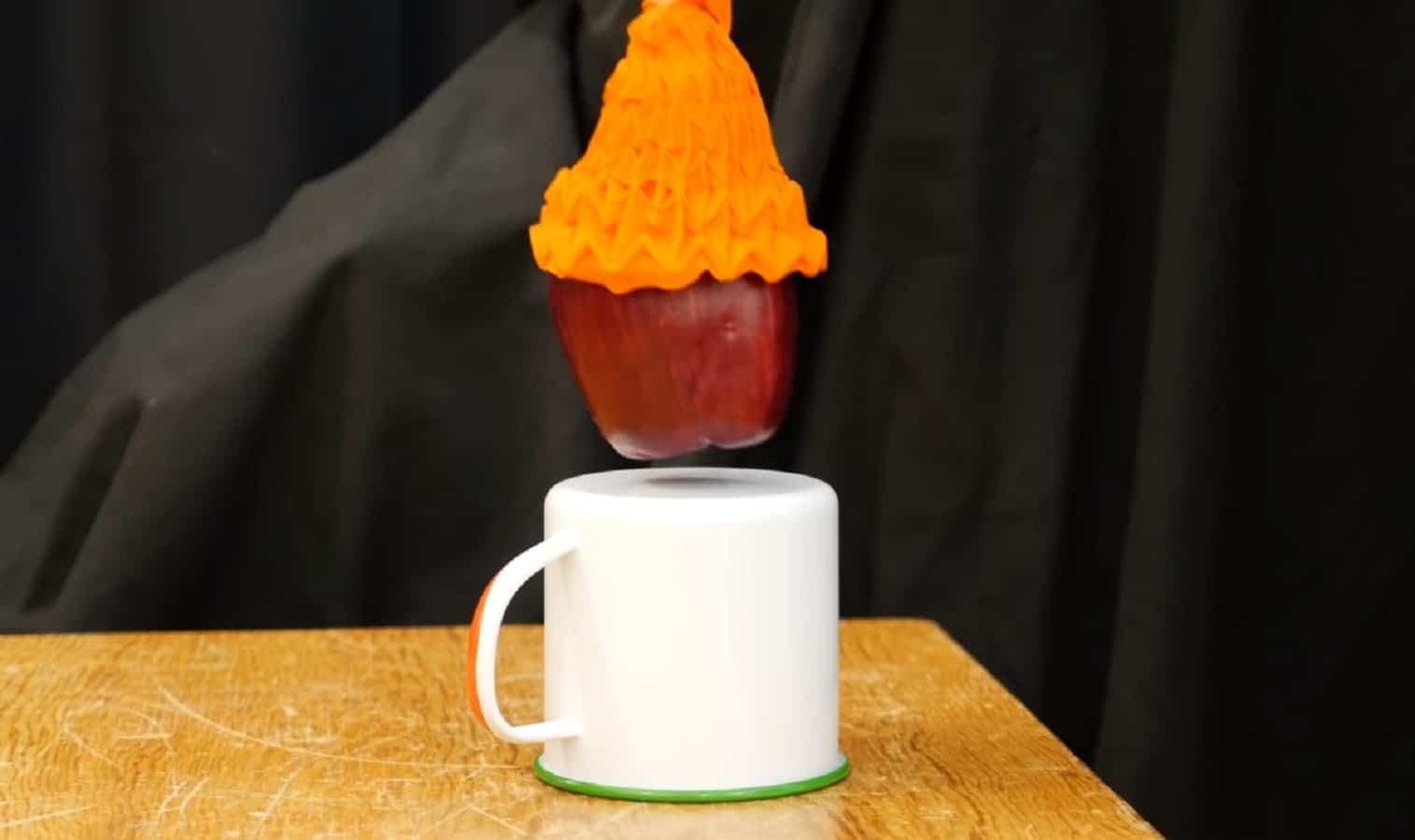 mit robotic gripper arm picking up apple