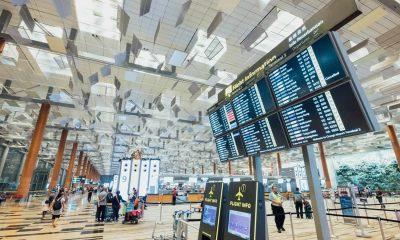 airport showing boarding times and flights tsa