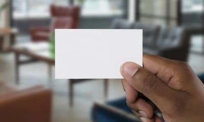 blank business card being held in front of camera