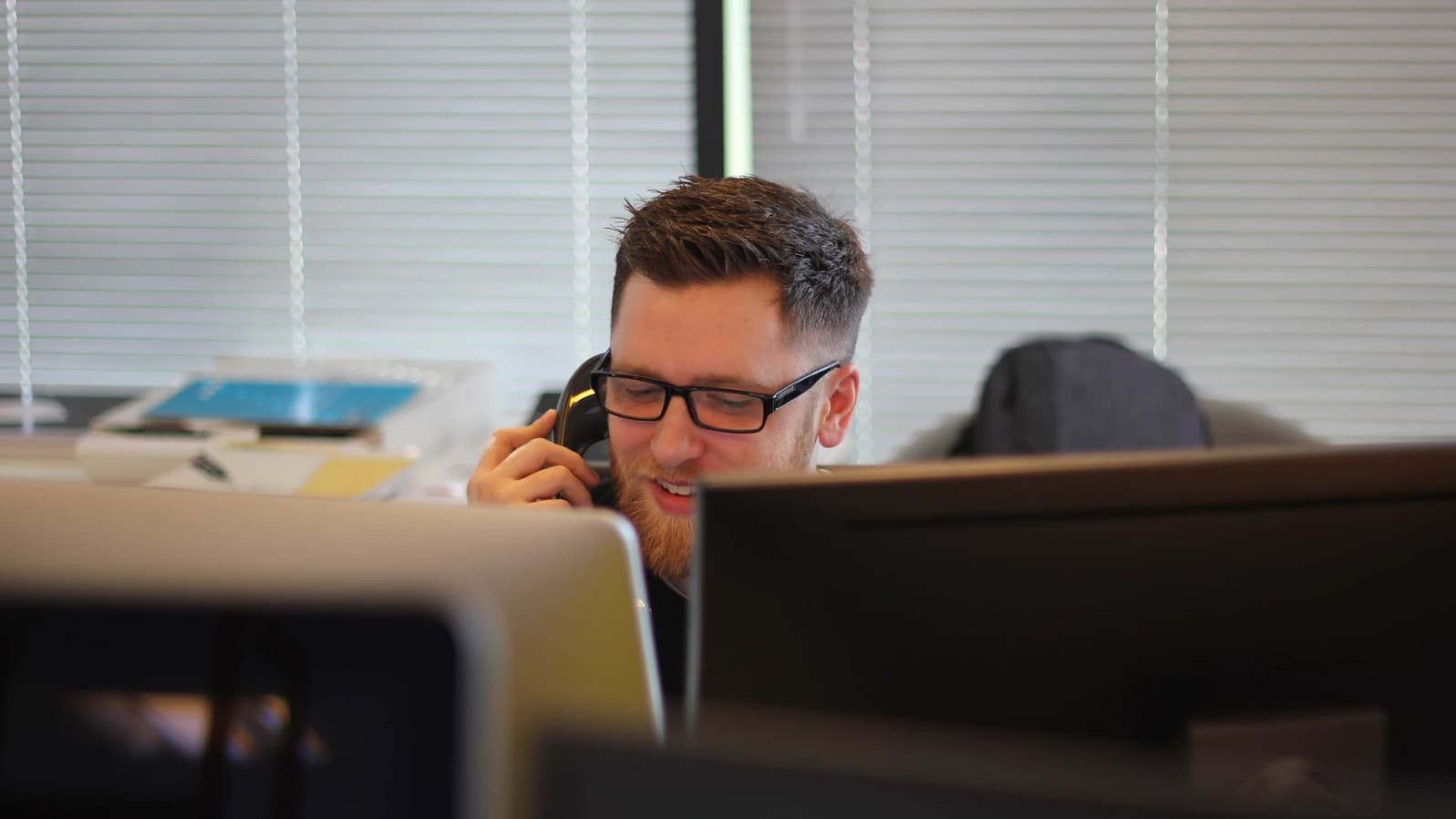 an employee on a phone call with customers