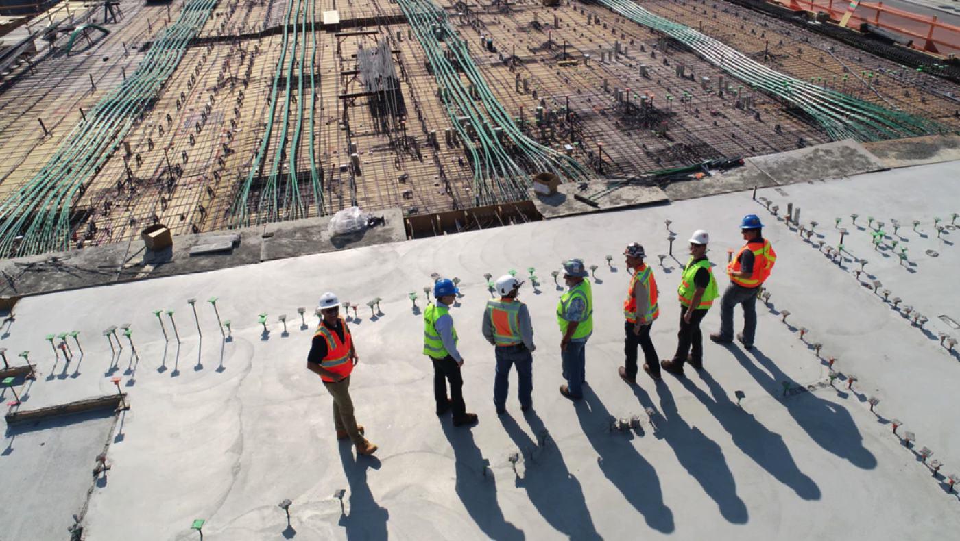 four men at a construction job site