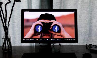 facebook on computer with binoculars