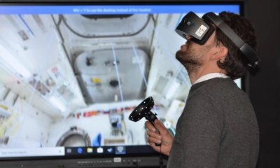 man using vr headset to explore a space ship