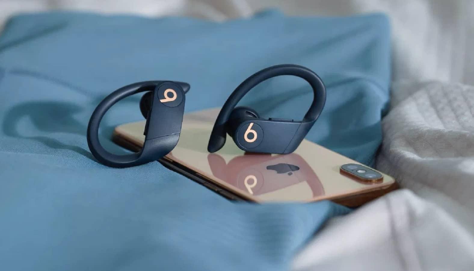 powerbeats pro beats wireless headphones sitting on iphone