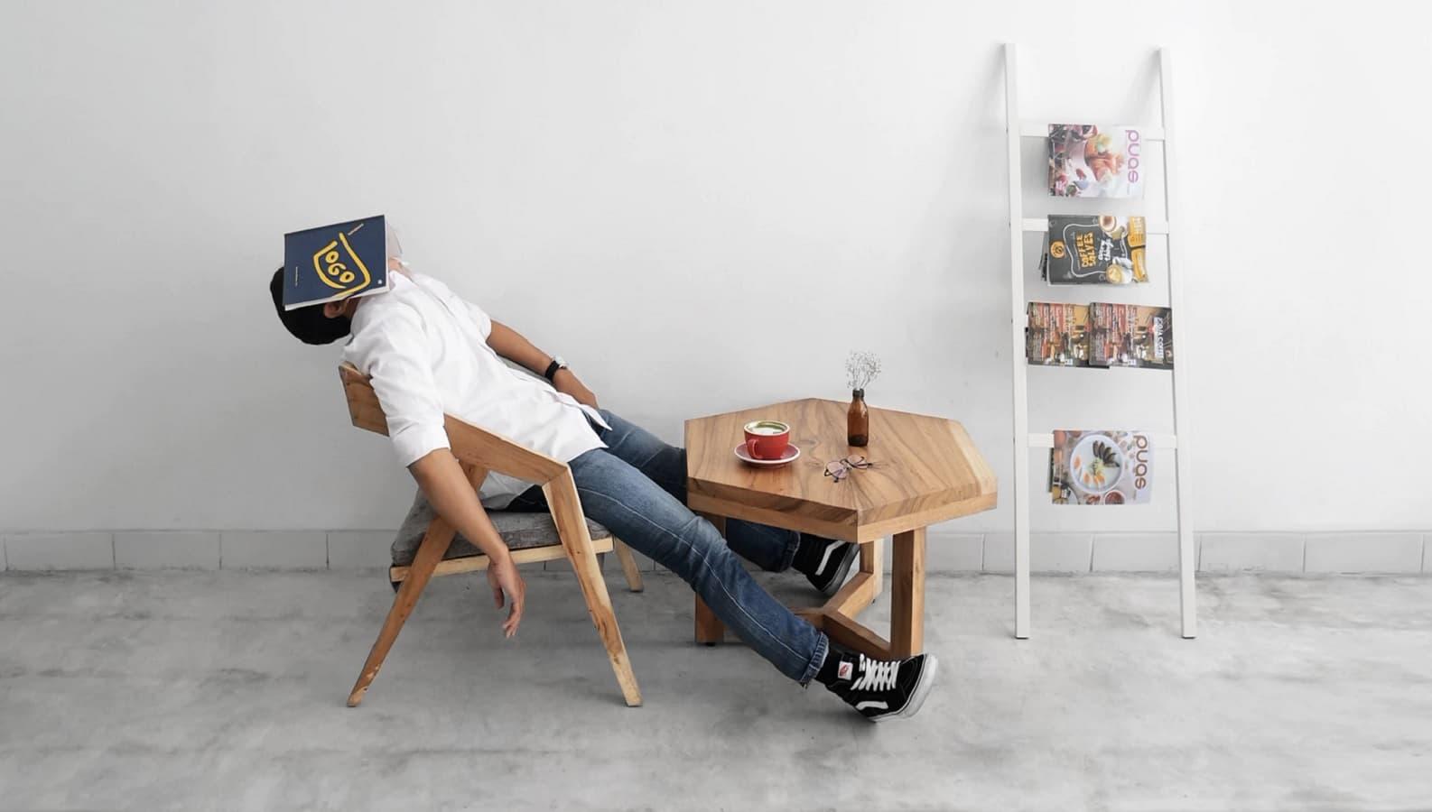 sleeping man at table