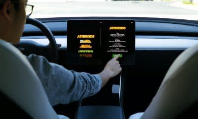 tesla car showing atari games on screen
