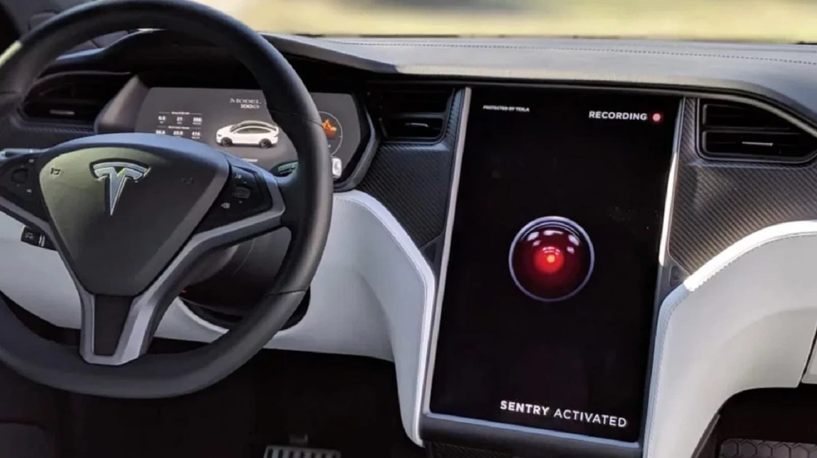 tesla car showing off sentry mode on screen