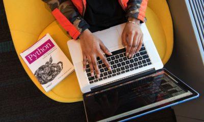 woman programming on a laptop